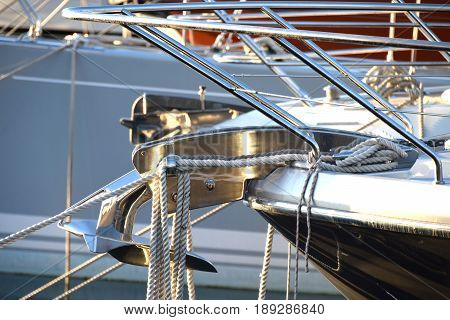 Motor on the stern of the modern yacht, moored in the marina