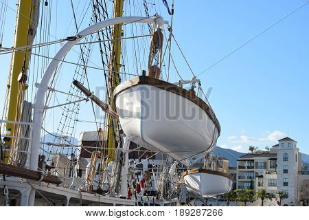 lifeboat hanging on the deck of the sailing ships