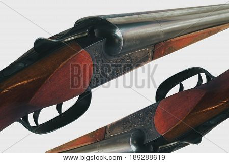 Detailed picture of a double-barreled gun on an isolated background.