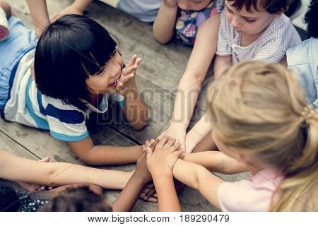 Kids are holding hands together
