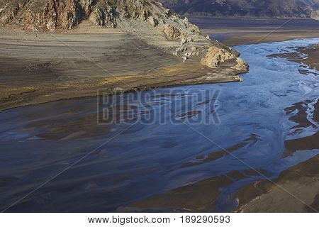 Mountain river flowing into Laguna de Laja in Laguna de Laja National Park in Bio Bio region of Chile.