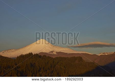 Snow capped peak of Antuco Volcano (2,979 metres) in Laguna de Laja National Park in the Bio Bio region of Chile.