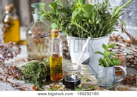 Herbs and spices flicking thyme rosemary Sustanon in a bucket on wooden planks