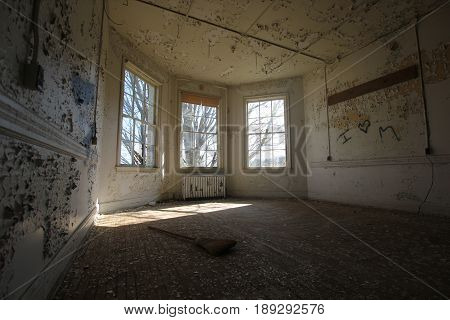 A light filled room of an abandoned asylum in Travese City, MI