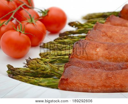 Bacon Wrapped grilled asparagus  with fresh tomatoes