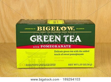 RIVER FALLS,WISCONSIN-JUNE 02,2017: A box of Bigelow brand green tea with pomegranate with a wood background.