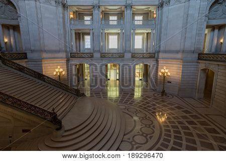 San Francisco, California, USA - June 1, 2017: San Francisco City Hall. The Rotunda with the Grand Staircase and White the Tennessee Pink Marble as seen from the 2nd f