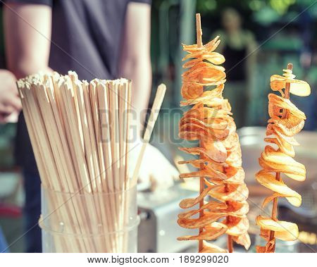 Potato Spirals Fried On The Stands Outdoors