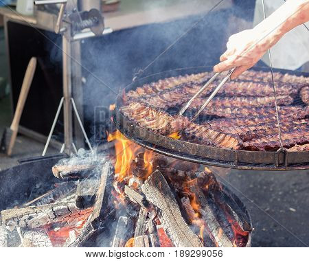 Cooking Meat On The Grill At Street Food Market