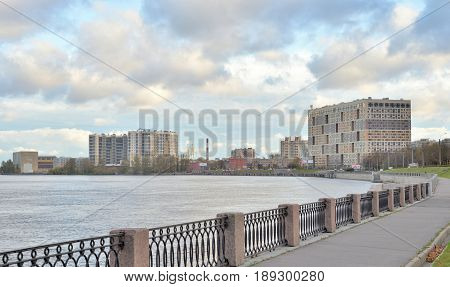 Embankment of the Obukhov defense of Neva River at cloud autumn day outskirts of Saint Petersburg Russia.