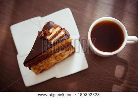 piece wof sweet brownie with chocolate on plate