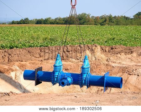 Crane Is Moving With New Gate Valve And 500 Mm Pipeline. Repairing Of Drink Water Pipeline