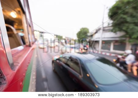 Blurred traffic jam on rush hour time shooted from buses .