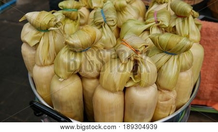 Boiled corn with husks Boiled corn in the husks and sold in bundles is a popular street food in southeast Asia