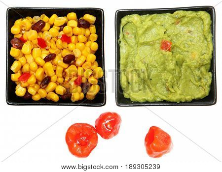 Bowl of Southwestern Corn, Guacamole and Peppadew Peppers over white.