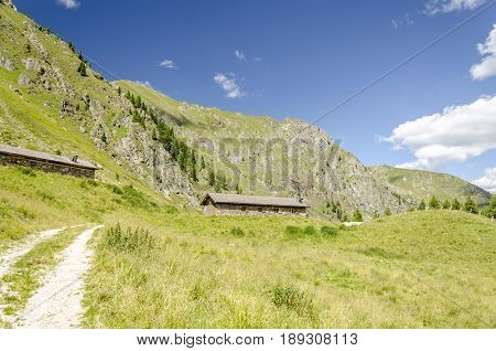 view of a lonely recreational home on the italian alps during summer