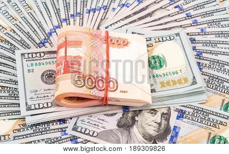 Folded five thousandths banknotes of russian roubles on the american dollars