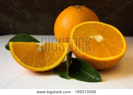 bright orange background from slices of juicy oranges with anise stars. orange background from slices of juicy oranges