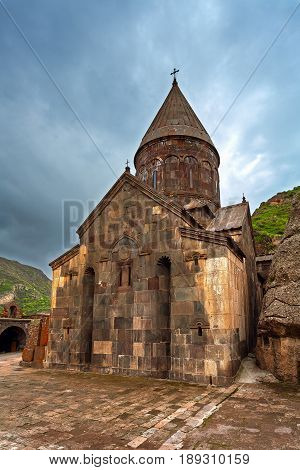 The architecture of the ancient monastery of tufa in the mountains. Armenian monastery Geghart