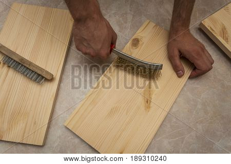 Sanding boards with a wire brush for further processing