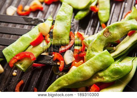french beans served with tomato and garlic