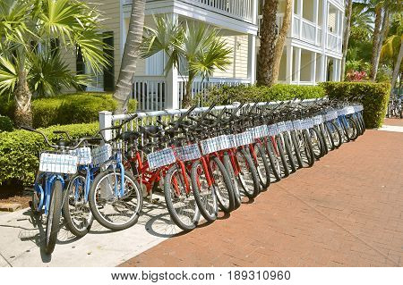 Key West Florida Keys Florida USA - May 15 2017 : Row of pedal bikes for hire in the centre of Key West
