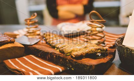 Ribs On The Grill With Clouse-up Sauce. Preparation Of Grilled Ribs With Sauce Close-up.