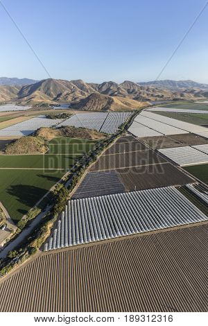 Farm fields and Santa Monica Mountains Parks aerial near Camarillo in Ventura County, California.