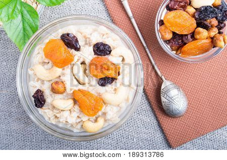 Top View Of A Portion Of Oatmeal With Fruit And Berries In A Glass