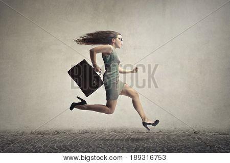 Late businesswoman running