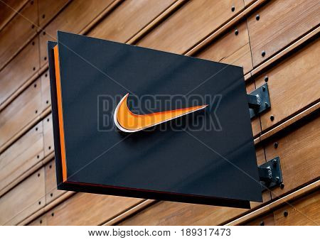 London, Uk - June 02, 2017: Nike Logo On Black Display Plate On Wooden Background. Nike, Inc. Is An