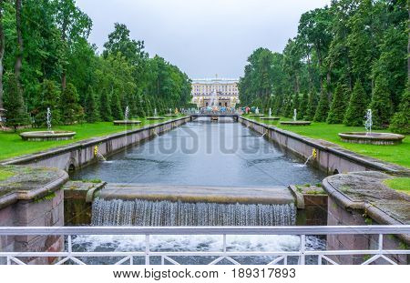 RUSSIA Peterhof - JULY 17 2013. Large Canal with fountain mascarons in the lower park