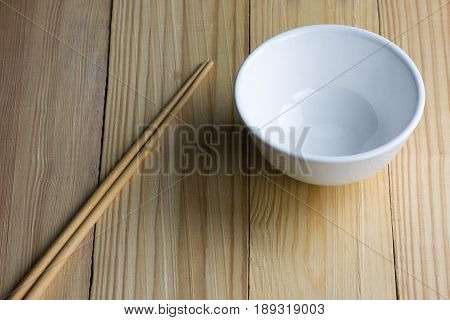 empty Bowl and chipsticks on the wooden table