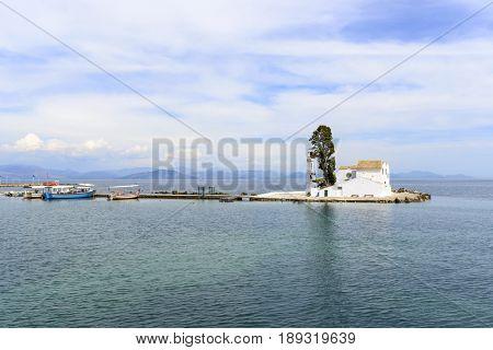 Old Greek Christian Orthodox church Vlacherna Monastery in Kanoni, Corfu island in Greece.