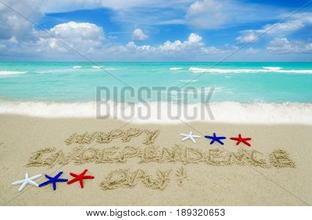 Independence USA background with white. red and blue starfishes on the sandy beach near ocean