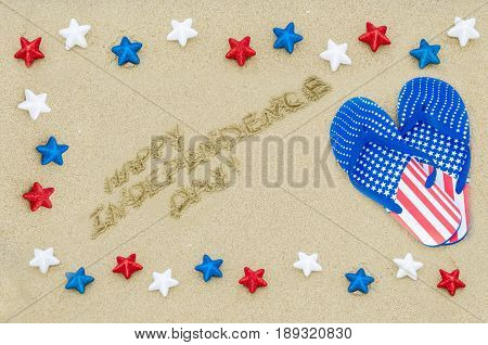 Independence USA background with stars and flip flops on the sandy beach