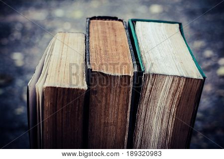 Ancient books on a wooden table literacy and knowledge concept