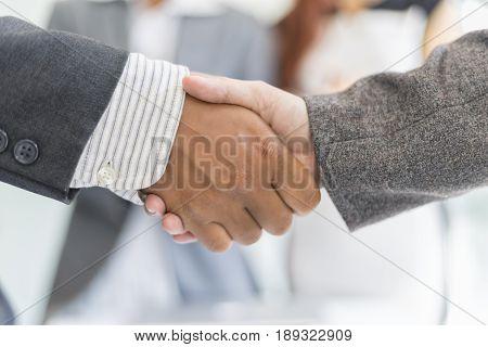 Business partnership handshake for deal business project Business success concept soft focus vintage tone