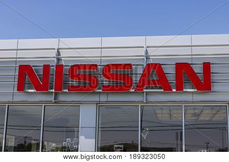 Lafayette - Circa June 2017: Logo and Signage of a Nissan Car and SUV Dealership. Nissan is part of the Renault-Nissan Alliance VI