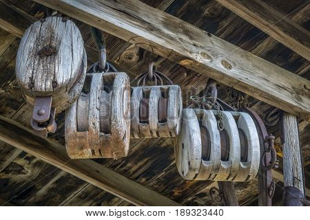 vintage wooden pulleys in an old barn or workshop