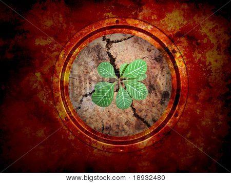 Green plant braird on the cracky soil. Round window