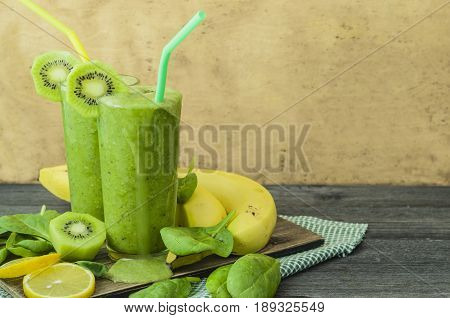 Spinach smoothie. Detox drink. Green, fresh and healthy banana cocktail with spinach. Picture with space for text or logos