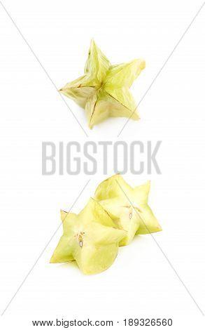 Sliced carambola starfruit fruit isolated over the white background