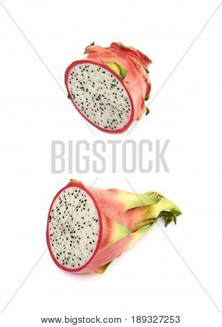 Sliced half of a vietnam dragon fruit pitaya isolated over the white background