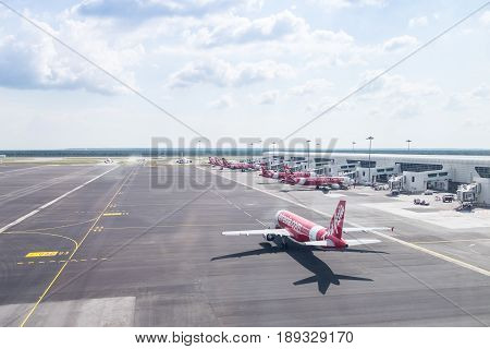 Kuala Lumpur, Malaysia - May 16, 2017: Many Airasia Plane And Clear Sky View From Terminal, Registra