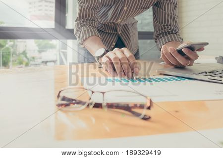 Business Man Do Turnover Graph Chart Of Company And Laptop Computer On Wooden Desk In Office