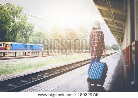 Alone Traveler Wait Suitcases Waiting For Her Train On Platform Of Railway Train Station In Summer.