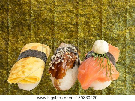 Various Sushi Set Isolated on White Background. Traditional Japanese Food with Fish and Green Seaweed