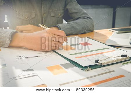 Business Man Do Turnover Graph Chart Of Company And Laptop Computer On Wooden Desk In Office. Group