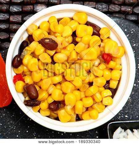 Southwestern Corn with black beans, yellow corn and tomatoes.